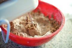 Hand mixer mixes cake ingredients, close up royalty free stock photos