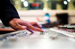 Hand on mixing board