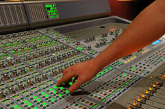 Hand on mixing console Stock Photo