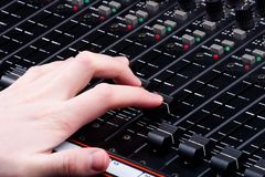 Hand on Mixing Console. Hand on Audio Mixing Console royalty free stock image