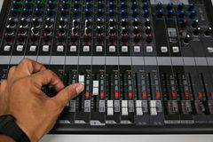 Hand on a Mixing Desk with vintage picture style, Music equipment in training room Stock Image
