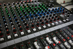 Hand on a Mixing Desk with vintage picture style, Music equipment in training room Stock Photography
