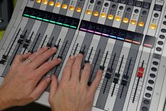 Hand mixing on Digital sound board used to mix audio royalty free stock images
