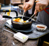 Hand Mixing Korean bibimbab hot pot. Royalty Free Stock Photo