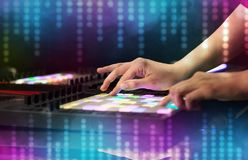 Hand mixing music on midi controller with social media concept Royalty Free Stock Photos