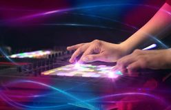 Hand mixing music on midi controller with wave vibe concept Stock Images