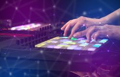 Hand mixing music on midi controller with connectivity concept. Hand remixing music on midi controller with colorful connectivity concept royalty free stock photos