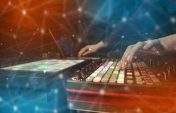 Hand mixing music on midi controller with connectivity concept. Hand remixing music on midi controller with colorful connectivity concept stock images