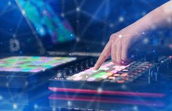 Hand mixing music on midi controller with connectivity concept. Hand remixing music on midi controller with colorful connectivity conceptn stock image