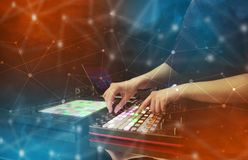 Hand mixing music on midi controller with connectivity concept. Hand remixing music on midi controller with colorful connectivity concept stock photos