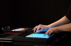 Hand mixing music on midi controller. Dj hand remixing music on midi controller stock image