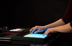 Hand mixing music on midi controller. Dj hand remixing music on midi controller royalty free stock photography