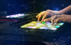 Hand mixing music on midi controller with play music and multimedia concept. Hand remixing music on midi controller with play music and multimedia concept stock photos