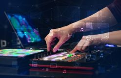 Hand mixing music on midi controller with play music and multimedia concept. Hand remixing music on midi controller with play music and multimedia  conceptn stock images