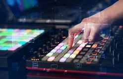 Hand mixing music on midi controller with play music and multimedia concept. Hand remixing music on midi controller with play music and multimedia concept stock photography