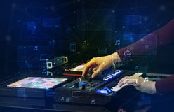 Hand mixing music on midi controller with play music and multimedia concept. Hand remixing music on midi controller with play music and multimedia concept royalty free stock photography