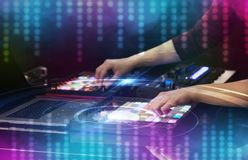Hand mixing music on midi controller with social media concept. Hand mixing music on dj controller with social media concept icons royalty free stock photos