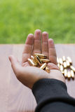 Hand with 9mm bullets. Hand holding bullets. Royalty Free Stock Images