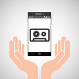 Hand mobile phone tape cassette Stock Images