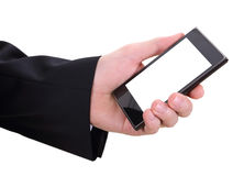 Hand and mobilephone. Closeup image of business man holding mobilephone Royalty Free Stock Images