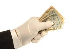 Hand & Money. White Gloved hand holding $20 dollar bills Royalty Free Stock Photo