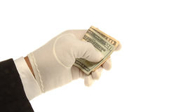 Hand & Money. White Gloved hand holding a $10 & $20 bill Royalty Free Stock Photos
