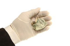 Hand & Money. White Gloved hand holding crumpled $20 bill royalty free stock photo