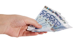 Hand with money. Money euro in hand on white Stock Image