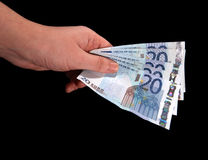 Hand with money. Euro money in hand on black Stock Images