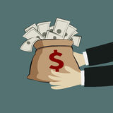 Hand and money bag Stock Photography