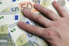 Hand on the money. Stock Image