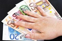Hand on Money Bills Royalty Free Stock Photo