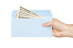 Hand and money in blue envelope Stock Image