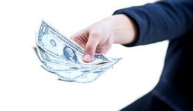 Hand with money. Hand of business women holding money isolated on white background royalty free stock photography