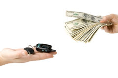 Hand with money and car keys Stock Image