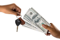Hand with money and car keys. Isolated over white stock image