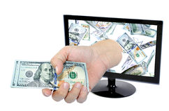 Hand with money comes from Computer monitor screen Royalty Free Stock Photos