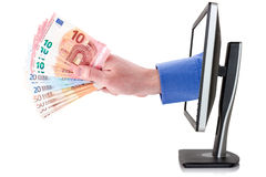 Hand with money coming out from computer monitor Stock Images