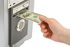 Hand with money and computer Stock Photo