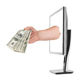 Hand with money and computer monitor Royalty Free Stock Image