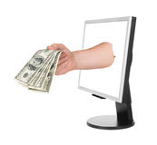 Hand with money and computer monitor Royalty Free Stock Images