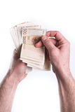 Hand money counting. Hand give or counting money on white background Stock Images