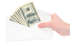Hand and money in envelope Stock Photo