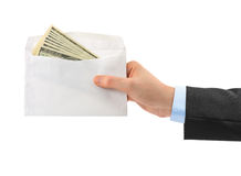 Hand and money in envelope Royalty Free Stock Images