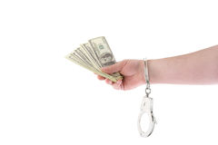 Hand with money and handcuffs Royalty Free Stock Photography