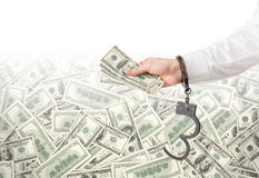 Hand with money in handcuffs Stock Photos