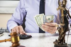 Hand money with judge  and calculator royalty free stock photo