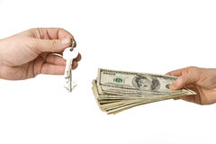 Hand with money and key Stock Photos