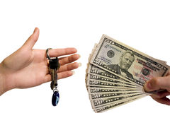 Hand with money and key on a white background royalty free stock photos