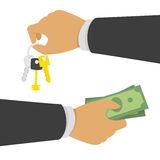 Hand with money and keys. Stock Photo